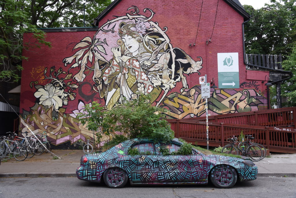 Jugendstil inspired graffiti with painted car in front of it