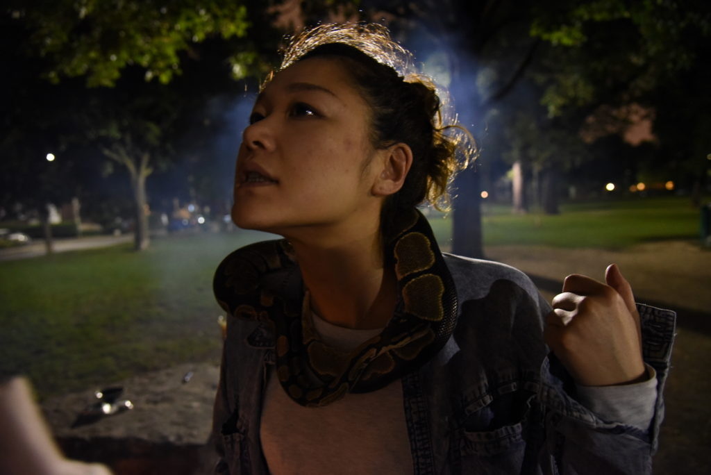 woman with snake around neck
