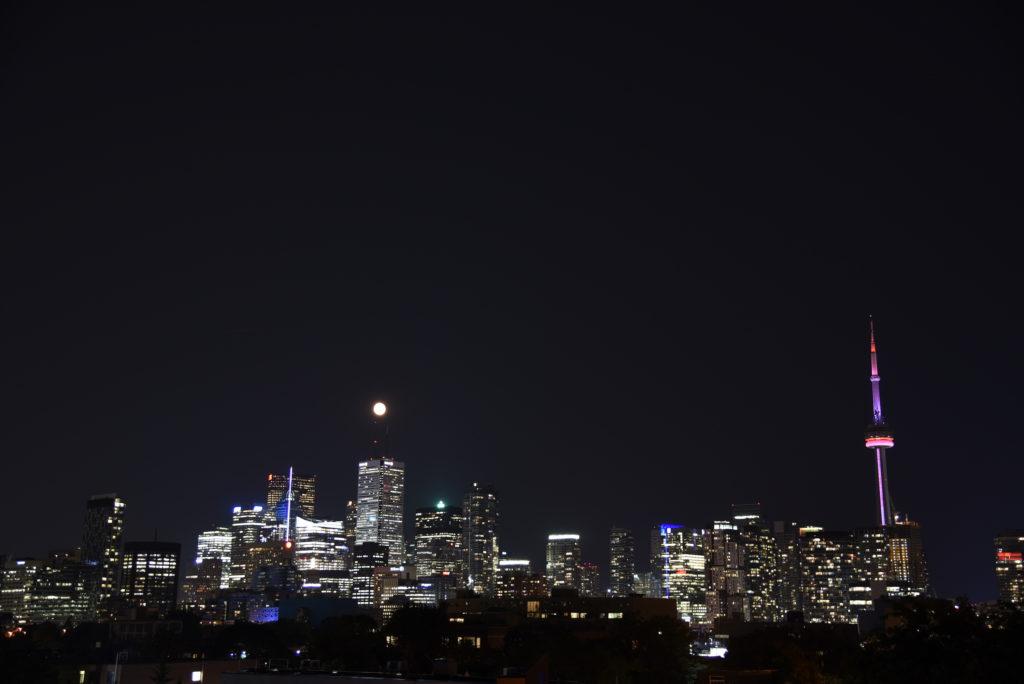 Toronto skyline by night with full moon