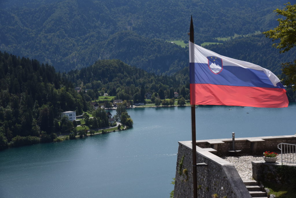 Slovenian flag with lake in the background