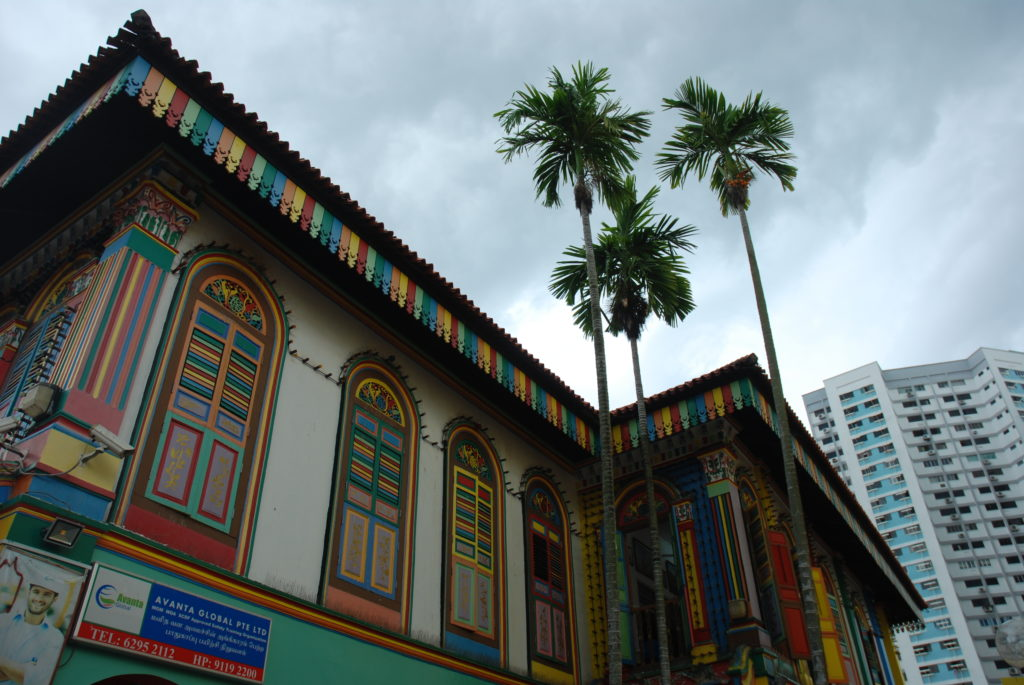 colourful building in Little India, with palm trees