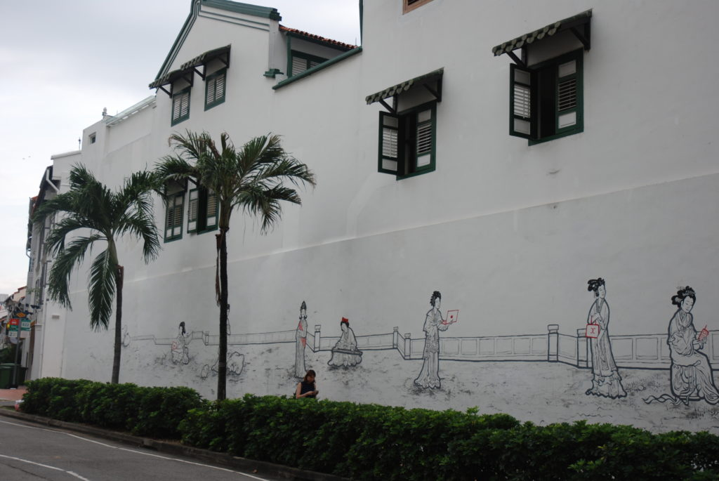 mural, and two palm trees in front of it