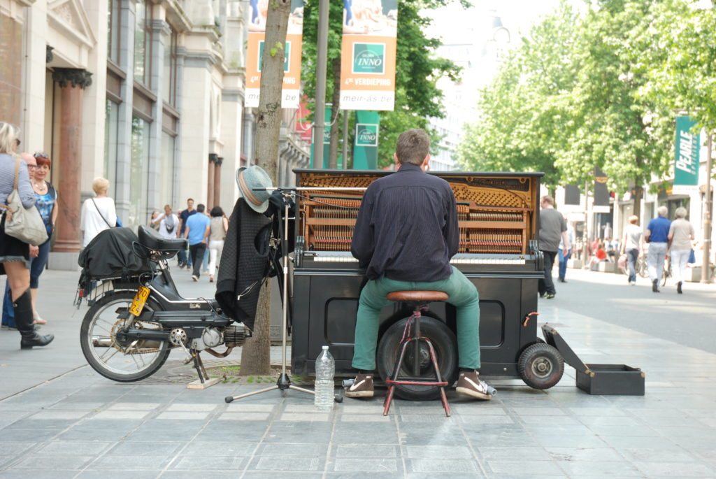busker with piano and moped