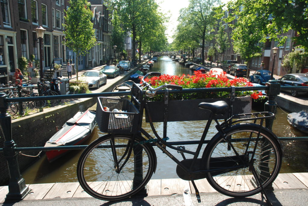 bicycle on a bridge over a canal in Amsterdam