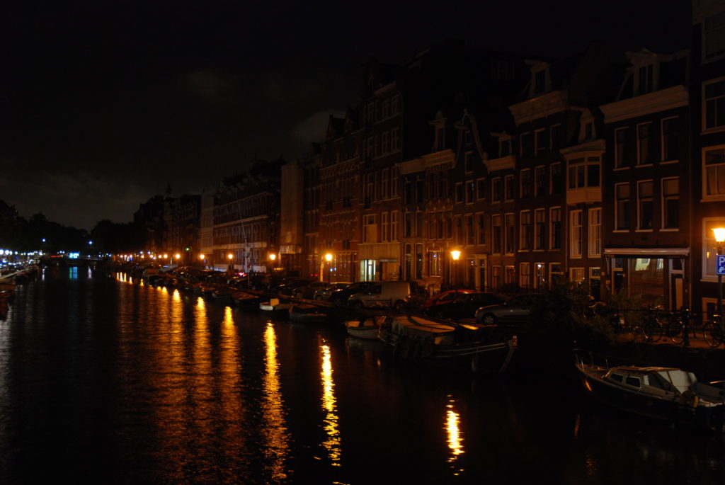buildings by the canal at night