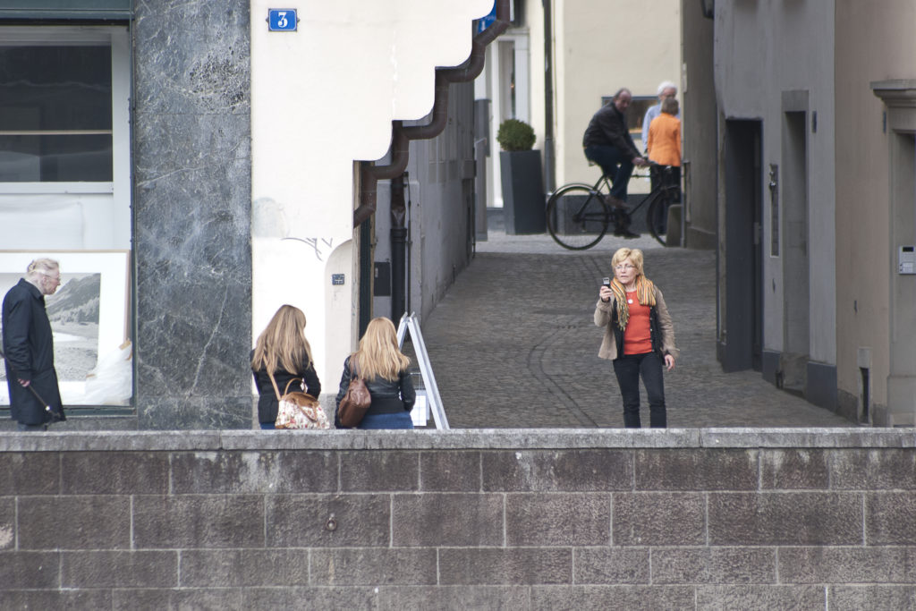woman taking photo of two girls