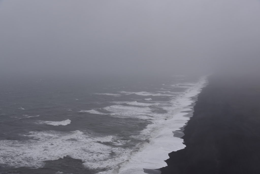 black sand beach in the fog