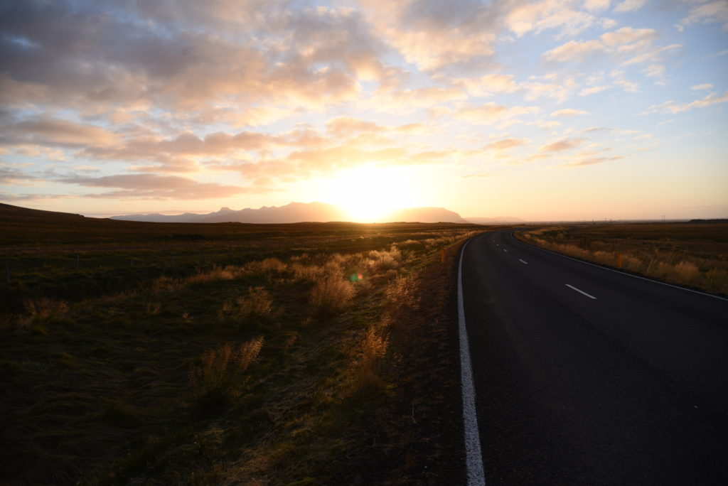 road in the Icelandic countryside at sunrise