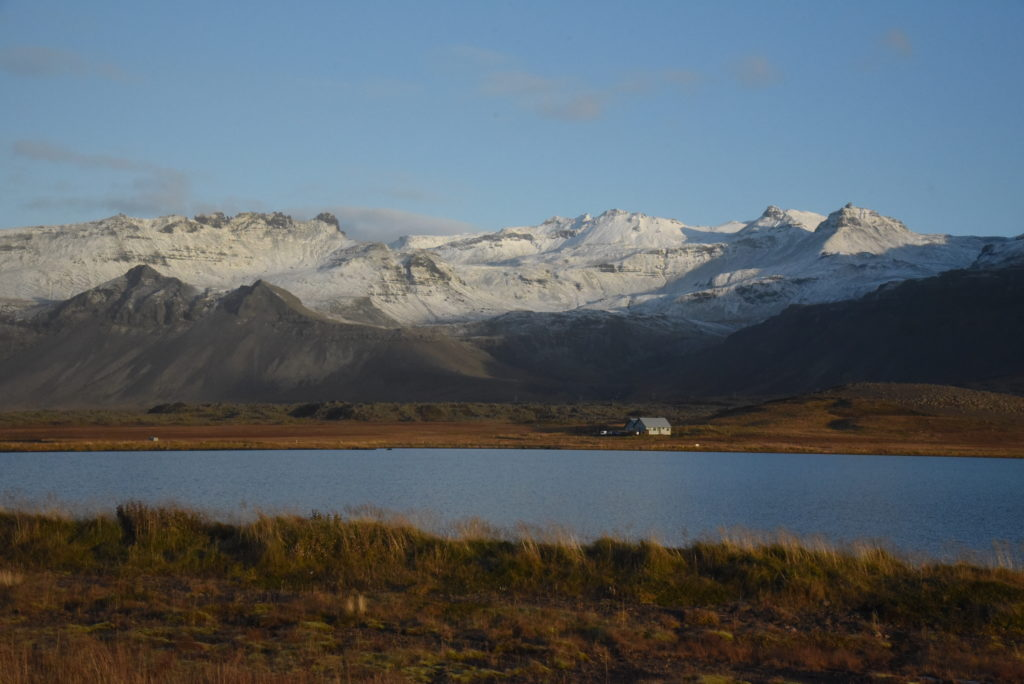 Icelandic countryside with snow covered mountains and lake