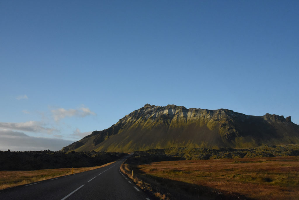road through the Icelandic countryside with mountains