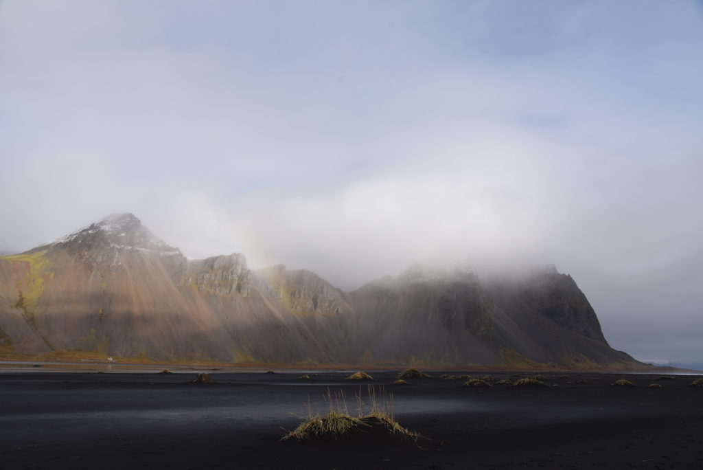 Vestrahorn mountain with black sand beach in foreground