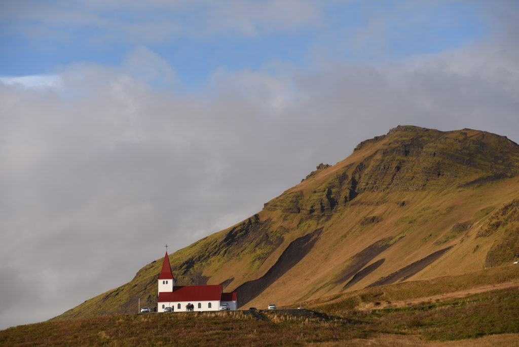church on top of a hill in Vík